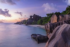Anse Source d'Argent (Seychelles) at sunset (lathuy) Tags: ocean africa longexposure sunset sea sky mer beach night de stars island islands la soleil indian coucher ile boulders filter national le tropical moonlight seychelles plage indien starry source geographic equatorial rochers digue praslin granit dargent ansesourcedargent mahé ndgrad mostbeautifulbeachintheworld