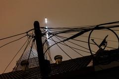 Discourses of Fragility (Rahat Alam) Tags: longexposure roof light urban rain night satellite wires malaysia sunway bandar