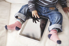 Small boy looking a tablet (Nasos Zovoilis) Tags: life city blue boy portrait brown white playing reflection cute love home apple beautiful face childhood closeup dark fun toy happy kid bed eyes hands toddler europe alone child play hand looking little sweet head expression background room small joy young adorable handsome son athens read greece health blond attractive casual worry inside charming care tablet hold ipad