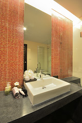 Bathroom design (ARZTSAMUI) Tags: flowers house home beautiful beauty television tile relax bathroom shower hotel design bath apartment counter sink cabinet designer interior vanity mirrors resort soak retreat tub fancy towels elegant comfort luxury decorated