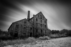 Fall Silent (jellyfire) Tags: longexposure chimney england blackandwhite mill monochrome architecture dark landscape ir mono suffolk factory unitedkingdom sinister dramatic industrialrevolution textile infrared unusual common mills emotive quirky atmospheric satanic eastanglia mellis robinsons 1740mmf4lusm midsuffolk canon5dmkii leebigstopper vision:mountain=0818 vision:sky=0642 vision:clouds=0713