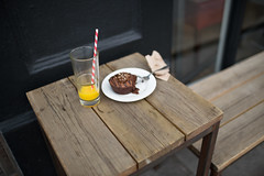 (ziemowit.maj) Tags: food london oldstreet centrallondon straightphotography urbanfragment woodentable woodenbench ef35mmf14l canon5dmkiii stripystraw barelytouchedchocolatecake orangejuiceleftovers