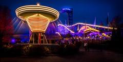 Amusement park (opjuhola) Tags: carousel night street light lights long exposure sunset architecture blue urban merrygoround amusement park photography helsinki yellow spinning trails roller coaster ride rollercoaster big dip op