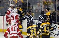 #54 Adam McQuaid and #29 Steve Ott are each given minor penalties for roughing (Odie M) Tags: nhl hockey icehockey boston tdgarden preseason teamsport sport ice tough fight roughing bostonbruins adammcquaid detroitredwings steveott lukeglendening drewmiller brianferlin dominicmoore mattgrzelcyk