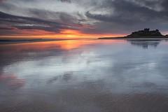 Bamburgh wet sands sunrise (Carl Mick) Tags: reflections longexposure sea eastcoast wetsands northeast sunrise robferrol seascape northumberland clouds sand coast bamburghsunriseseascapecastle northeastcoast leefilters sky