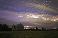 Busy Night (Matt Molloy) Tags: mattmolloy timelapse photography timestack photostack movement motion night sky stars trails clouds lightning flashes barn fireflies planes field trees violet ontario canada nature landscape lovelife