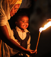 No one is indifferent to fire (ybiberman) Tags: israel jerusalem churchoftheholysepulchre deirelsultan mother child fire candle portrait candid streetphotograpy fear enthusiasm night ethiopian
