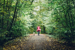 A Dog and a Pink Rain Coat (freyavev) Tags: dog bike bicycle girl pink nature autumn green path forest woods germany deutschland korntal badenwrttemberg vsco outdoor 50mm depthoffield niftyfifty mikasniftyfifty
