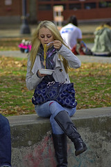 Lunch (swong95765) Tags: woman hungry blonde lady female noodles seated lunch park boots jeans