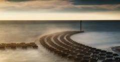 Midday Sunset (Nigel Jones LRPS) Tags: photoshop nikefex colorefex sunset faux sea waves groynes felixstowe