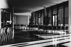 Conference for Nothing (Thomas Listl) Tags: thomaslistl blackandwhite noiretblanc lightandshadow chairs architecture windows contrast hall