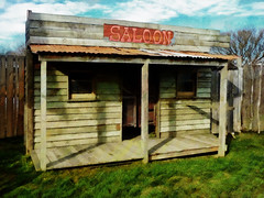 The Willowbank Saloon (Steve Taylor (Photography)) Tags: saloon cowboy western swing doors porch architecture replica weatherboard roof sign fence wooden newzealand nz southisland canterbury christchurch willowbank wildlifereserve grass shadow corrugated metal iron bar