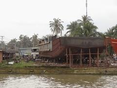 Under construction (program monkey) Tags: vietnam mekong river delta cargo boat ben tre tra vinh construction build yard repair