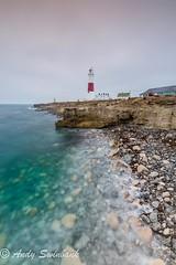 Portland Bill Lighthouse. (andrewswinbank) Tags: longexposure water stones coast gitzo leefilters canon seascape jurassiccoast landscape dorset lighthouse portlandbill