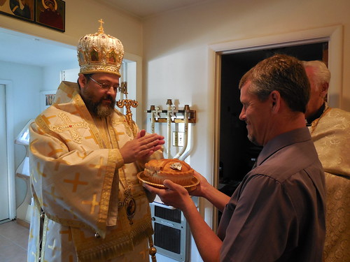 HIs Grace, Bishop Gregory is presented with the traditional gifts of ...