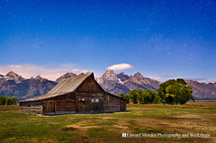 Moulton Barn by Stars (Edward Mendes) Tags: park wood longexposure nightphotography blue brown white mountains green texture nature grass horizontal night clouds barn landscape star evening nationalpark architechture outdoor scenic moose jackson astrophotography wilson moonlight wyoming range grandteton jacksonhole moulton starfield jacksoncounty mormonrow cooltone antelopeflats cottonwoodtrees starpoints moultonbarn johnmoultonbarn