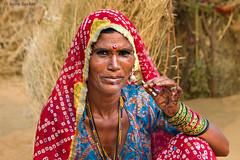 Smoking Woman (Irene Becker) Tags: portrait india rural countryside desert outdoor cigarette smoke traditional smoking marketplace pushkar saree rajasthan imagesofindia pushkarcamelfair incredibleindia indianimages pushkarcattlefair livestockfair pushkarkamela irenebeckereu
