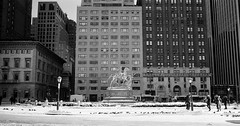 Grand Army Plaza (september.) Tags: nyc newyorkcity blackandwhite bw horse snow streets film fountain statue 35mm buildings midtown crop pedestrians canonae1 kodaktmax400 grandarmyplaza 5thave nycparks canonfd canon28mmf28 wtshermanstatue