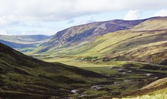 Looking South from Glenshee. (artanglerPD) Tags: red mountains sunshine river spring glenshee lorry