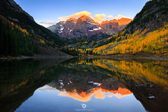 Bells are ringing! (Mohanram Sathyanarayanan) Tags: autumn sky sunrise lake mountains winter water cold blue sun light fall orange snow colors calm mirror aspens still colorado vibrant rockies aspen alpenglow relfections maroonpeak
