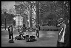 Buskers At Dusk - Washington Sq., Greenwich Village (March,2009) (Ebanator) Tags: zeiss zeissikon zeissstuttgart contaflexprima zeisspantar4528 pantar45mmf28 fujineopan greenwichvillage buskers musicians newyorkcity washingtonsquare manhattan streetphotography contaflex prima zeisscontaflexprima jazz