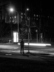 Lone traffic (Suho_Ja) Tags: lowlight light traffic long exposure olympus m43 night evening black dark streak man person standing street streetphotography road gloomy shadows dim bw