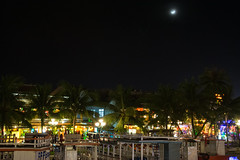 Evening in Hoi An (Xnalanx) Tags: asia boat buildings environment hoian manmade moon night objects places plants restaurant river sky time trees vehicles vietnam water
