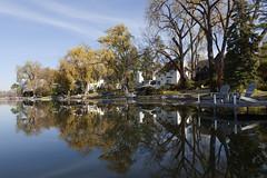 reflections on Cedar Lake (Lucie Maru) Tags: lake cedarlake water reflections mirror mirrorreflections reflectionsinwater fall fallcolors landscape horizon minnesota minneapolis urbanpark park