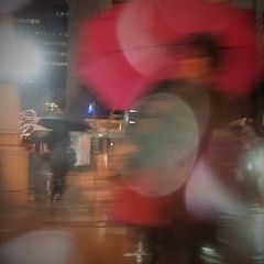 Woman In Red (michael.veltman) Tags: from a cab in the rain woman red umbrella chicago illinois