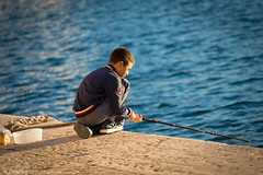 Fishing (People, Places, Culture - N. Delbrck Fotografie) Tags: apulien puglia italia boy ocean light travelphotography portrait people culture life sea water italy europe canoneos6d canon ef70200mmf4lusm documentaryphotography streetphotography childphotography children fishing