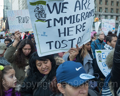 Anti-Trump Protesters march on Central Park South, New York City (jag9889) Tags: jag9889 president signboard demonstration manhattan banner people 20161113 outdoor donaldtrump centralparksouth immigrants text newyork rally march midtown immigration newyorkcity 59thstreet elect usa sign trump 2016 protester ny nyc unitedstates unitedstatesofamerica us