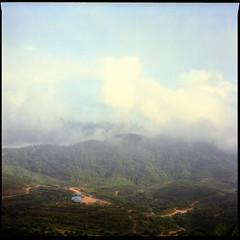 Misty Morning. . . (Hafiz_Markzzaki) Tags: morning mountains misty clouds mediumformat landscape hills malaysia kelantan mamiyac330s kodakektacolorpro160 sekor80mmf28 hafizmarkkzaki jalanfeldaaring