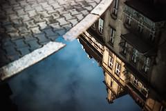 netherland (ewitsoe) Tags: city sky reflection building water rain 35mm reflections landscape puddle mirror europe poland sidewalk lookingdown curb poznan watery jezyce nikond80 ewitsoe erikwitsoe