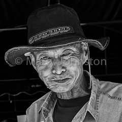 The man with the hat (Marty Johnston) Tags: old portrait blackandwhite bw man monochrome face hat festival contrast asian thailand temple blackwhite cowboy asia expression buddhist buddhism celebration thai wat cowboyhat lowkey wrinkles facial lanna wrinkled lamphun manwithhat greatphotographers weatheredface salakyom