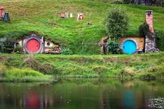 Waterfront Properties, Hobbiton (Emily Miller Kauai) Tags: newzealand holes northisland lordoftherings hobbit movieset thehobbit millpond hobbiton matamata