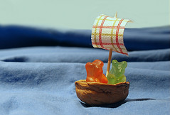 sail away with me (brescia, italy) (bloodybee) Tags: blue sea stilllife food macro fun boat candy sweet humor walnut shell wave explore sail nut nutshell jellybears 365project