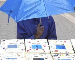 Blue man, selling blue . . (fred's_pix) Tags: newyorkcity blue umbrella hotday e500