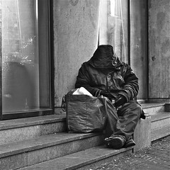 When your coat is your only shelter... (Akbar Simonse) Tags: street people urban bw man holland blancoynegro netherlands monochrome square zwartwit candid homeless nederland streetphotography denhaag bn thehague streetshot straat dakloos lahaye sgravenhage straatfotografie straatfoto akbarsimonse vision:outdoor=0724