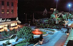 Lincoln Road Mall night view Miami Beach FL (Edge and corner wear) Tags: lighting beach water fountain modern night vintage mall lights store pc shoes bright florida beck miami postcard joy modernism pedestrian architect chrome storefront colored morris feature midcentury lapidus