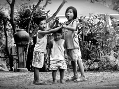 Rhyming Games (ulli_p) Tags: people blackandwhite bw art canon children fun thailand asia southeastasia isan blackwhitephotos flickraward ruralthailand earthasia thebestshot bestflickrphotography totallythailand artofimages mygearandme canoneoskissx5