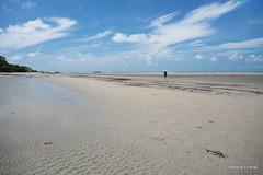 The Clouds, The Sand, and The Tourist (gprana) Tags: beach indonesia olympus m43 belitung cplfilter manggar micro43 microfourthirds olympusomdem5 olympusmzuiko1250mmf3563 bwmrcnanoksmcircularpolarizer