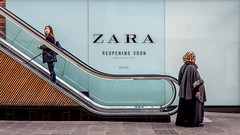 Which way now? (Ric George) Tags: women bristol town up fur escalator shopping street shoppers mobile streetscene opposition shoppingcentre zara streets streetlife