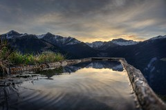 Right then it dawned on me (PeterThoeny) Tags: mountain landscape fountain water reflection waterreflection outdoor schuders switzerland swissalps graubnden grison sunrise cloudy cloud dawn day hdr 3xp raw nex6 selp1650 photomatix qualityhdr qualityhdrphotography fav100