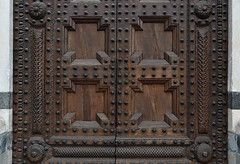 Baptistery... Pistoia (henryark) Tags: door baptistery wood iron studs nails brown marble carrara pistoia decorations details coffered carvings outdoor nikon nikond750 enrico nannini henryark tuscany italy green white composition town
