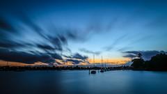 Sunset (Marcos Venicius) Tags: sunset auckland new zealand sun beach sea blue orange sky long exposure boat