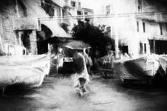 man with umbrella (www.streetphotography-berlin.com) Tags: streetphotography street streetlife impressionism impressionistic man umbrella rainyday rain boats parking walking italy riomaggiore fishing village blackandwhite blackwhite