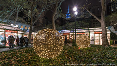 Bryant Park Winter Village (20161203-DSC07627) (Michael.Lee.Pics.NYC) Tags: newyork bryantpark wintervillage iceskating esb empirestatebuilding newyorkpubliclibrary holiday christmas 2016 decoration market night cityscape architecture sony a7rm2 voigtlanderheliar15mmf45