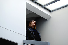 immobile (petuulia) Tags: girl woman staircase stairs escalier cage baie vitre window white blanc portrait scene lipstick blond leather jacket nikon d3100 35mm petulia digital photography