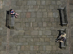 From the tower (shaggy359) Tags: above people church saint st bench reading three michael couple sitting floor cathedral pavement read single sit paving trio coventry benches