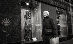 a shopping day : old woman (Le Xuan-Cung) Tags: winter urban blackandwhite bw woman sun sunlight paris france face reflections daylight lightsandshadows nikon thought mood alone ledefrance noiretblanc